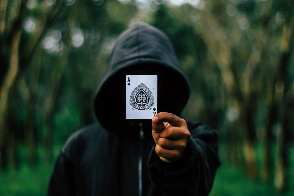 hooded man with ACE card